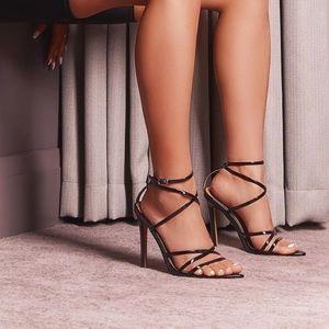 Black strap up heels.